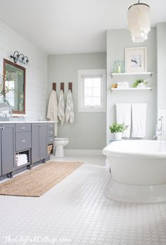 Lake House Master Bath, grey cabinets, white hex floors, planked walls and cool blue paint give this lake house bath a coastal cottage feel.