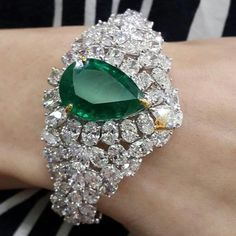Enjoy total #wristcandy with this stunning 17.66 carat Zambian Emerald set in a Statement cuff with oval and PearShape diamonds from @diamantinafinejewels