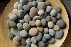 I would love to find beautiful river rocks like this for my backyard. Currently there's a bunch of cheap rocks as cover, and it looks... well.. cheap.