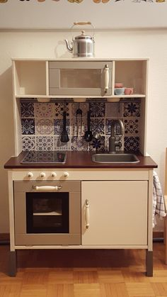 Ikea Duktig children kitchen Makeover - another makeover for inspiration. Love the 'tiles'!