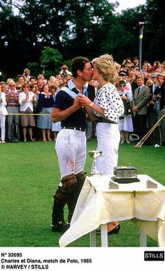 July 21, 1985: Princess Diana kisses her husband, Prince Charles at a polo match at Cowdray Park in Sussex.