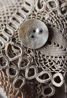 neutrals.quenalbertini: Button on crochet blanket