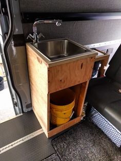 Prototype sink unit made from packing crate plywood Bamboo Panels, Metal Panels, Camper Kitchen, Sink Units, Jerry Can, Van Living, Shower Hose, Sink Drain, Diy Kitchen Cabinets
