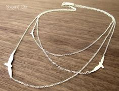 collier oiseau argenté 3 rangs de Shlomit Ofir