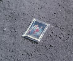 """""""Charles Duke brought a photo of his family with him and like everything else they carried, it needed to be isolated from the environment with plastic. It's hard to say exactly what motivated him to photograph it lying on the surface of the moon, but it's not that hard to say. ... It made me realize that all the other NASA photos of the moon's surface were actually color photographs. It was the moon that was monochrome, not their film."""""""