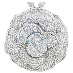 Fabulous is the only way to describe the Butler & Wilson Swarovski Crystal Round Flower Clutch Bag Clear.  Featuring Swarovski crystal, it is perfect for adding a touch of sparkle to your outfit.