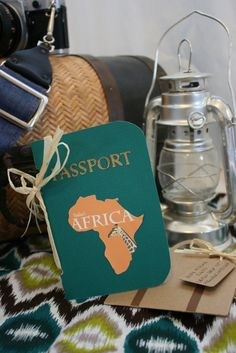 Invitation cute and easy (?) emboss passport on dark blue thick paper with madagascar on the front