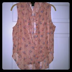 ????Adorable floral tank top ties at bottom Pink sheer tank top. Ties at the bottom. Perfect for summer nights Tops Tank Tops
