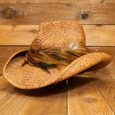 Straw hat with cool feather band.