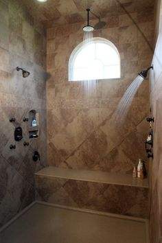 "Hockmans Bathroom Remodel , This bathroom was transformed into the ""Dream Bathroom."" It includes a huge walk-in shower, a washer and dryer in the huge walk-in closet, the bathroom is even complete with a coffee bar!, Inside the shower with the water running.   , Bathrooms Design"