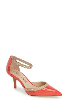Gold studs add extra polished appeal to these suave coral pointy-toe pumps.