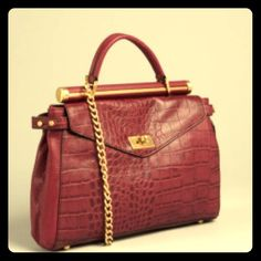 BCBGMAXAZRIA Pebbled Leather Satchel, Merlot (Red) Wine colored leather textured satchel bag, this piece is stunning any way you where it. Its size is small yet the pockets are wide and fit more than expected! Durable, convenient, and gorgeous. BCBGMaxAzria Bags Satchels