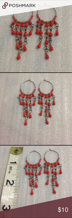 Beaded orange dangle earrings Beaded orange and peach  dangle earrings.  Approximately 2 1/4 inches at the longest point Jewelry Earrings