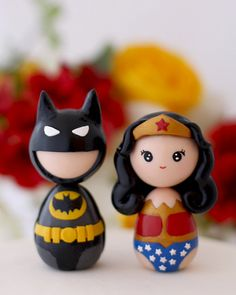 This should have been Lilly's cake topper.  Custom Wedding Batman Wonderwoman cake toppers by Chikipita