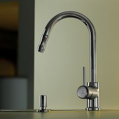 Fantastic designer high-end modern luxurious single lever kitchen faucet sink mixer with pull out spray in polished chrome.