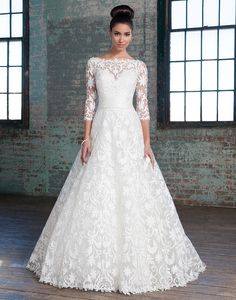 Justin Alexander signature wedding dresses style 9815 Innovative laser cut lace and satin ball gown with top stitching features a romantic Sabrina neckline, Silk Dupion cummerbund and V-back neckline.