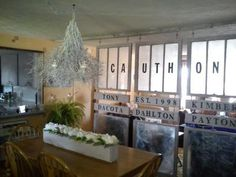 I used old windows to create a wall divider between our living room and dinning room. Our last name across the windows, with our names on top with our