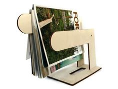 Now trending: Laser cut wood magazine display,magazine rack,magazine stand,wooden magazine holder,magazine organizer,magazine storage,wood newspaper rack https://www.etsy.com/listing/254783585/laser-cut-wood-magazine-displaymagazine?utm_campaign=crowdfire&utm_content=crowdfire&utm_medium=social&utm_source=pinterest