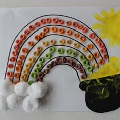 St. Patrick's Day craft - Fruit Loops rainbow, cotton ball clouds & finger painted pot o' gold