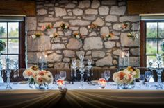 The wedding party table done up beautifully with warm accent colours.