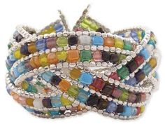 """Braided Mosaic Bead Cuff Bracelet Zad Jewelry. $17.99. Cuff bracelet measures 1¾"""" wide and features 3 lines of braided mosaic beads and silver metal seed beads."""