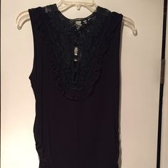 Dressed sleeveless tank Size large, Black sleeveless top from the buckle, dressy, with high neck crochet detailing and button up.  Rouching on the sides. Like new, only worn a few times. Very cute! Dayspring Tops Tank Tops