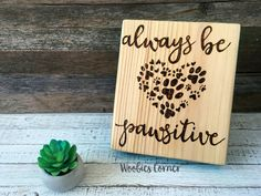 Always be pawsitive, Inspirational sign, Animal lover gift, Veterinarian gift, Dog sign, Dog wood sign, Positive quotes, Motivational sign  Always be pawsitive sign is made using real wood. Each piece has been hand decorated combining pyrography (wood burning) for the entire design and is sealed with a two coats of high quality finish to make your decor last a lifetime. A variety of border colors are available, your color chosen will be painted with an acrylic paint and lightly sanded down…