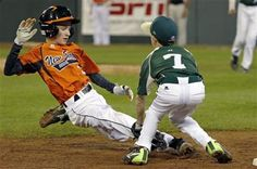 Pearland, Texas third baseman Presley Smith (7) tags out Cumberland's CJ Davock attempting to steal third to end the third inning of a baseball game in United States pool play at the Little League World Series tournament in South Williamsport, Pa., Friday, Aug. 15, 2014.