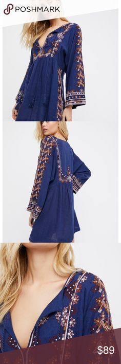 """Starlight mini dress 2 mediums Style: 40950792   Embroidered mini dress with a beautiful bohemian feel. Features a center cutout with adjustable tie accents. Easy shape with wide, relaxed sleeves.  75% Rayon 25% Linen Hand Wash Cold Import Measurements for size Small Bust: 37"""" = 93.98 cm Length: 32.5"""" = 82.55 cm Sleeve Length: 24.5"""" = 62.23 cm Free People Dresses Mini"""