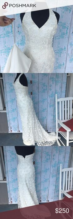 Michaelangelo Davids Bridal halter wedding dress Michaelangelo Davids Bridal halter beaded wedding dress with train size 10. In great condition but needs to be dry cleaned. Sorry it is not my size so I can't model. David's Bridal Dresses Wedding