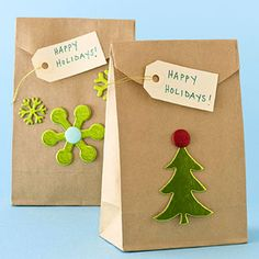 BROWN GOODY BAGS - Embellish a simple brown bag with stickers and tags to make fun and simple holiday grab bags.