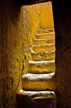 If she only took the right staircase, would it lead her back to a better place, a happier time?