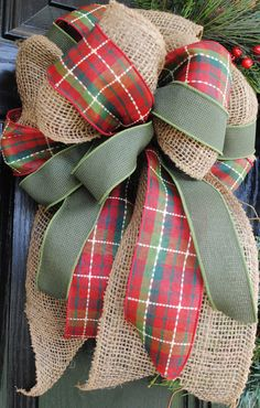 Christmas Wreath Holiday Wreath Wiinter Wreath Evergreen Pine Cranberries Pinecones Burlap Bow 20 inch. $68.00, via Etsy.