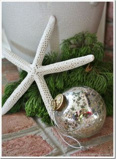 Love the aged mercury glass ornaments - vintage and beachy at the same time!