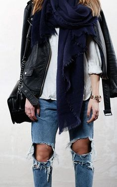 Ripped jeans, scarf and leather jacket.