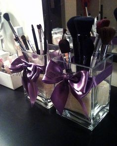 Vase with sand to hold makeup brushes.. Love this!!!