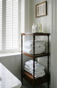 Don't be afraid to use those beautiful antique pieces in the bathroom for extra storage.  They make a great display of things!  James Michael Howard