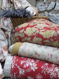 some old, some new french quilts . a little bit of red