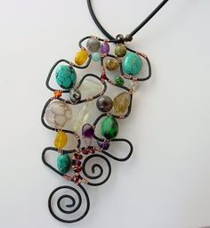 """like the free-form design that the artist calls a """"Picasso Pendant"""" (not a how-to) from: http://beadcomber.blogspot.com/2010/07/not-just-polymer-clay.html#"""