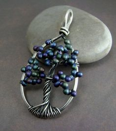 """fairey tree pendant - Like the different take on the """"Tree of Life"""" motif."""
