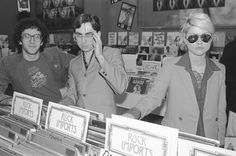 Chris Stein and Deborah Harry of Blondie shopping at a record store