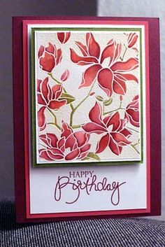 """By Anni. Uses Hero Arts """"Large Blossom"""" stamp. Stamp in VersaMark & heat emboss in white. Color using water brush dipped in Distress reinkers. Add mats & sentiment."""
