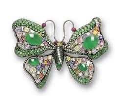 A jadeite and multi gem set brooch