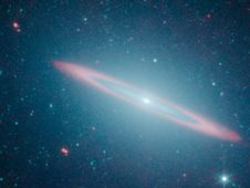 NASA's Spitzer Finds Galaxy With Split Personality.    While some galaxies are rotund and others are slender disks like our spiral Milky Way, new observations from NASA's Spitzer Space Telescope show that the Sombrero galaxy is both.