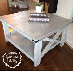 White washed grey industrial square coffee table.