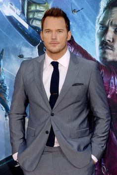 Wearing a a gray sharkskin suit with a blue knit tie and a polka dot pocket square, it's no wonder Chris Pratt ranked at #2 on People magazine's list of Sexiest Men Alive.