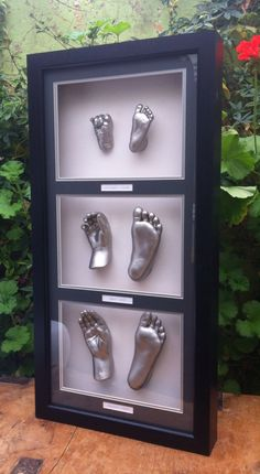 A hand and foot of each of 3 children. Little to large.