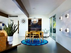 Richard Neutra - love the set-up: round table on a round rug to divide the space