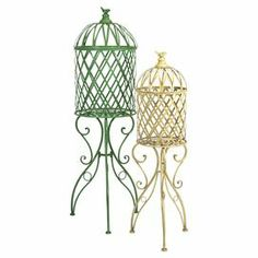 """Display an array of decorative orbs or highlight faux floral arrangements with this charming birdcage decor set, crafted of iron and showcasing green and white finishes.  Product: Small and large birdcage decorConstruction Material: 100% IronColor: Green and off-whiteFeatures:  Scrolled baseLattice designBird finial accent Dimensions:Small: 44.5"""" H x 11"""" DiameterLarge: 54.75"""" H x 15"""" Diameter"""