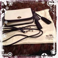 Purple/White Coach Coach HandbagLegacy Archive Collections, cross body bag detachable strap for a clutch very clean inside and out used once but I have a black one.. No PayPal so don't ask Authentic Dark Purple and White (8inLx5inW). Coach Bags